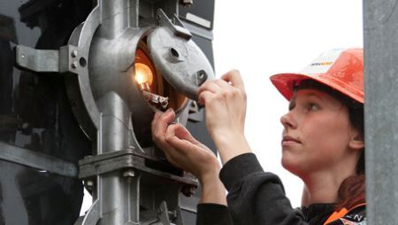 Technician working on signaling system
