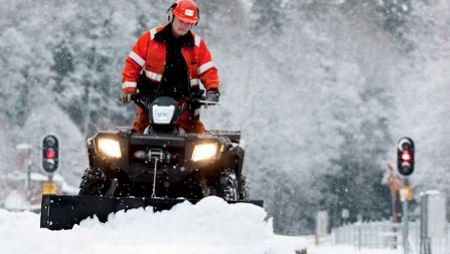 Quad bike with plow clears tracks